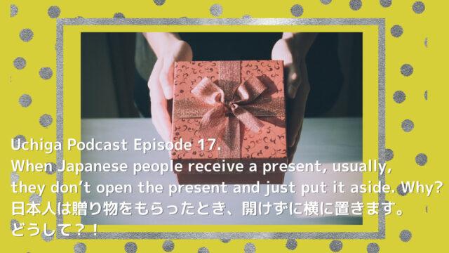 オリーブグリーンとシルバーの水玉背景。プレゼントを両手で渡す写真の前に、「Uchiga Podcast Episode 17. When Japanese people receive a present, usually, they don't open the present and just put it aside. Why? 日本人は贈り物をもらったとき、開けずに横に置きます。 どうして?!」と書かれている。